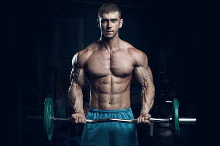 Photo for Male bodybuilder, fitness model trains in the gym - Royalty Free Image