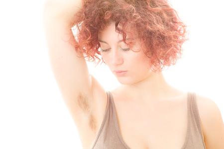 Foto de Pretty Woman with Hairy Armpit on White Background - Imagen libre de derechos