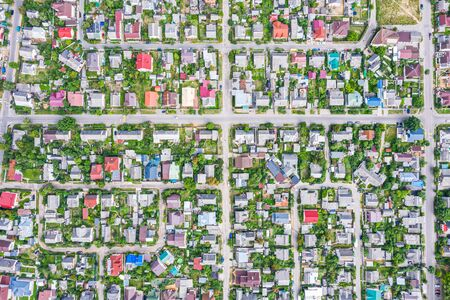 Photo pour aerial top view of suburb area with houses and asphalt roads. viewpoint from directly above - image libre de droit