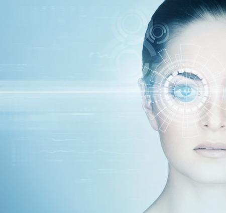 Foto de Young woman with a digital laser hologram on her eyes (ophthalmology, eye surgery and identity scanning technology concept) - Imagen libre de derechos