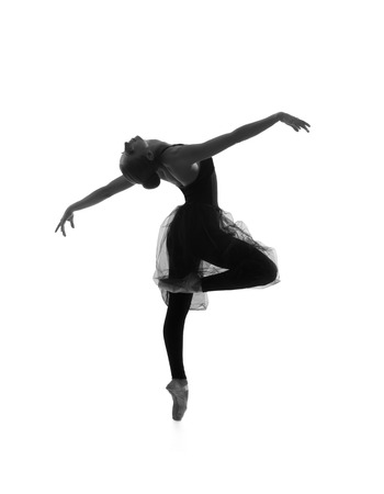 Foto de Black and white trace of young beautiful ballet dancer isolated over white background - Imagen libre de derechos