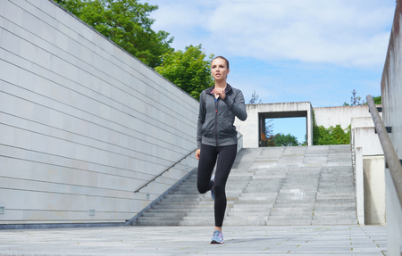 Photo pour Young, fit and sporty girl running up the stairs. Fitness, sport, urban jogging and healthy lifestyle concept. - image libre de droit