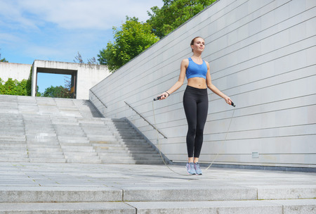 Photo pour Young, fit and sporty woman. Fitness, sport, urban and healthy lifestyle concept. - image libre de droit