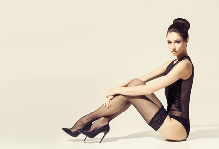 Photo for Beautiful woman in erotic underwear and stockings. - Royalty Free Image