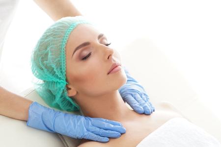 Photo pour Woman getting palpation massage treatment. Recreation, Rejuvenation, Health, Massage, Healing Concept. - image libre de droit