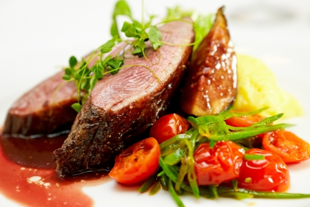 Photo for Glazed duck fillet, mashed potatoes seasoned with truffle oil, fig and aniseed sauce - Royalty Free Image