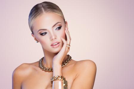 Photo pour Young lady with luxury accessories on beige background - image libre de droit