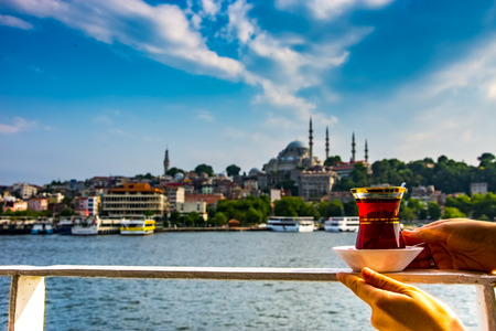 Photo pour The turkish tea on the sea in Istanbul with beautiful background of Istanbul city and blue sky - image libre de droit