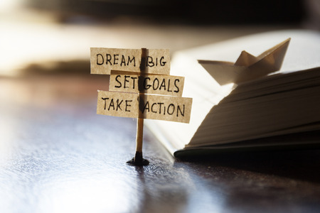 Foto de Dream Big, Set Goals, Take Action, concept, tags on the table. - Imagen libre de derechos