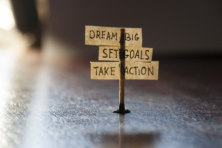 Photo pour Dream Big, Set Goals, Take Action, concept, tags on the table. - image libre de droit