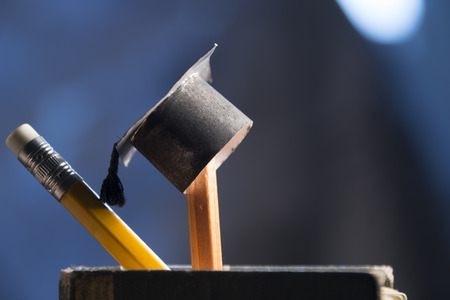 Foto de pencils and graduation hat, education concept - Imagen libre de derechos