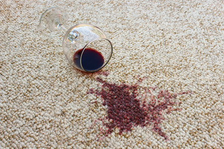 Photo pour glass of red wine fell on carpet, wine spilled on carpet - image libre de droit