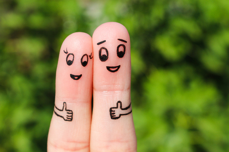 Photo pour Finger art of a Happy couple. Happy couple showing thumbs up - image libre de droit