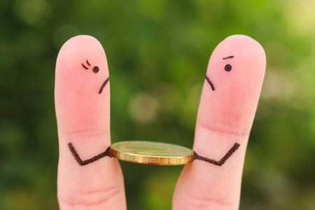 Foto de Fingers art of family during quarrel. Concept of man and woman can not divide money after divorce. - Imagen libre de derechos