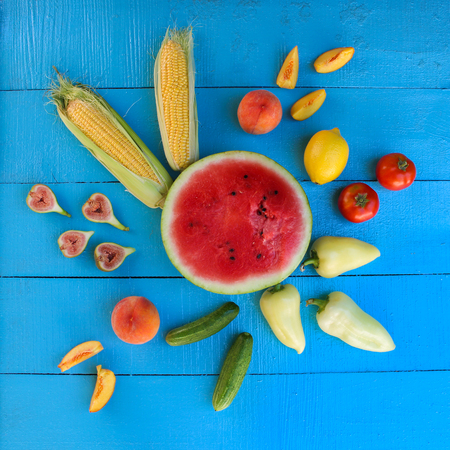 Fruits and vegetables on blue wooden background.Top view, flat lay.