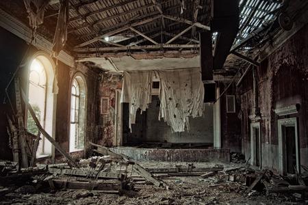 Foto de Old creepy abandoned rotten ruined haunted theater, a ragged curtain, Sukhum, Abkhazia - Imagen libre de derechos