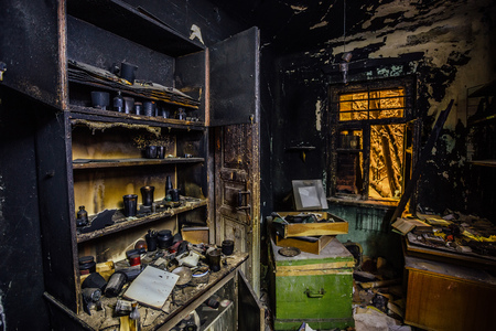 Photo for Burnt house interior. Burned kitchen, furniture, door, charred walls and ceiling in black soot. - Royalty Free Image