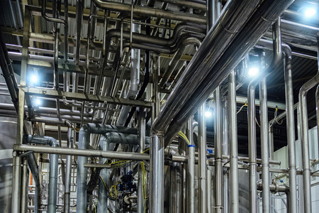 Photo pour Industrial pipeline system in brewery for ingredient transportation. Abstract industrial pipeline background. - image libre de droit