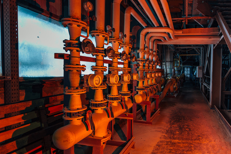 Photo pour Steel industrial pipeline with valves and manometers in corridor of abandoned factory. - image libre de droit