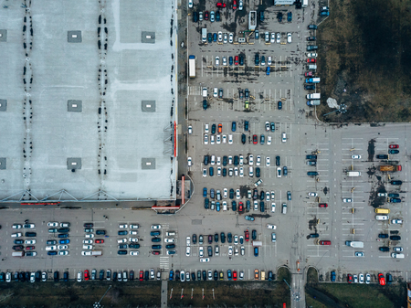 Photo for Top view of parking lot near large trade center taken by drone. - Royalty Free Image