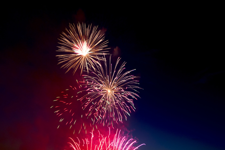 Photo pour Beautiful colorful holiday fireworks on the black sky background,  long exposure - image libre de droit