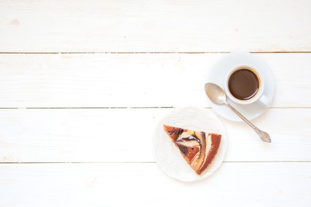 Photo for Piece of chokolate cake and cup of coffee on white wooden table. Top view image of restaurant or cafe menu background. - Royalty Free Image
