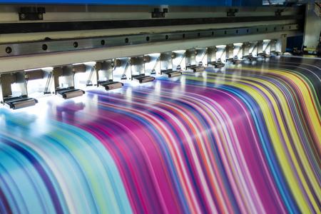 Photo for Large inkjet printer working multicolor cmyk on vinyl banner - Royalty Free Image