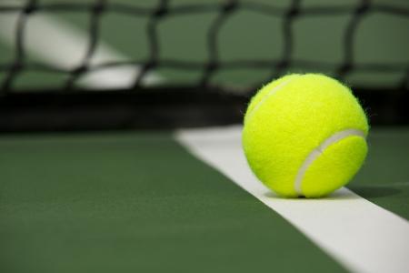 Tennis Ball on the Court near the Net