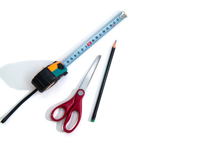 Photo pour Roulette, scissors and pencil on a white background, tools for measuring and cutting - image libre de droit