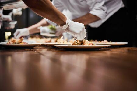 Photo for Chef preparing dish. - Royalty Free Image