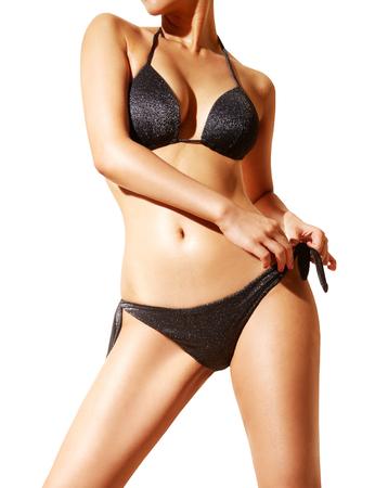 Foto de Beautiful woman body with black bikini and sunglasses. isolated on white... - Imagen libre de derechos