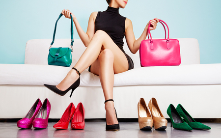 Foto für Colorful shoes and bags with woman sitting on the sofa. - Lizenzfreies Bild