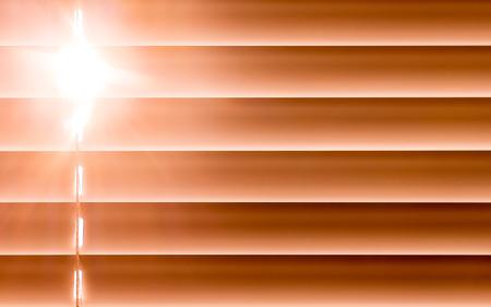 Foto de orange horizontal blinds on the window create a rhythm, through the intervals the light passes through - Imagen libre de derechos