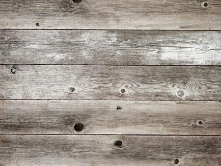 Foto de Rustic silver grey weathered barn wood board background showing rich grain and knots - Imagen libre de derechos