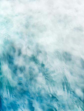 Foto de Painterly, tranquil, and meditative blue green flowing water background fade to white - Imagen libre de derechos