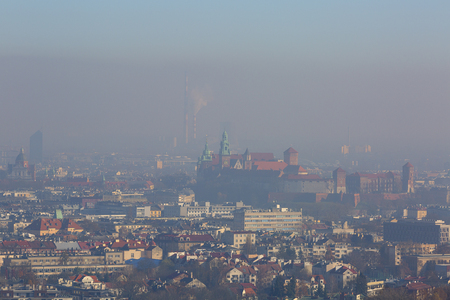 Photo for Dense smog over the city, air pollutant, aerial view of the old town Krakow, Wawel Castle, Poland - Royalty Free Image