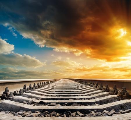 railway to horizon under sunset