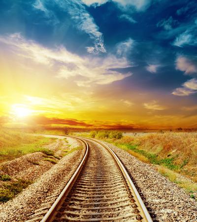 Photo pour good sunset in colored sky over railroad - image libre de droit