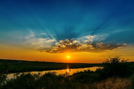 Photo pour fantastic sunset over river - image libre de droit
