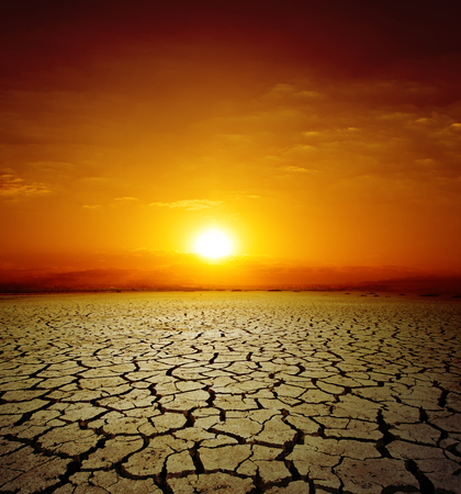 Photo pour red sunset over drought earth. change of climate - image libre de droit