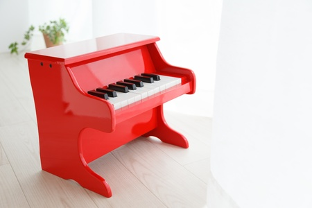 Miniature piano placed by the window