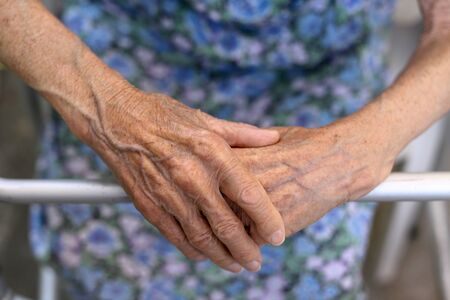 Foto per Old ladys hand. Elderly lady is waiting for help. Senior lady experiencing bad service and conditions in retirement nursing home.Elderly concept. Aging concept - Immagine Royalty Free