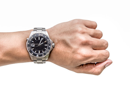Foto de A man hand with Watch on wrist isolated over a white background - Imagen libre de derechos