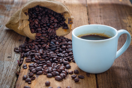 Photo for coffee cup and coffee beans on old wood - Royalty Free Image