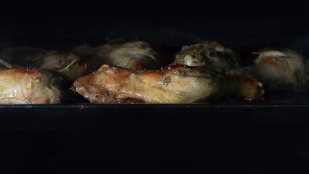 Foto de roast chicken in the oven. - Imagen libre de derechos