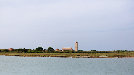 View of Torcello Cathedral and bell tower on the island of Torcello, Venice, Italy