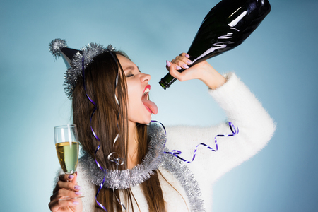 Photo for young drunk girl drinks the remains of champagne - Royalty Free Image