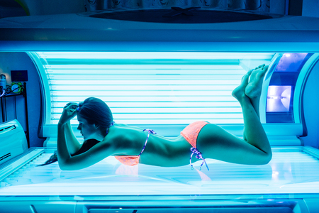 Photo for shapely beautiful young girl sunbathing in a solarium, wants a beautiful tanned skin - Royalty Free Image
