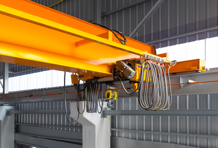 Foto de Factory overhead crane installation on rail, can movement to every where in factory area  - Imagen libre de derechos