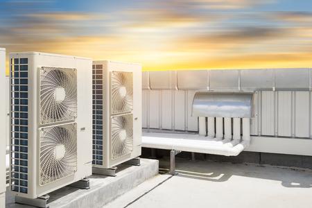 Photo pour Air compressor machine part of air conditioner system on roof deck with sky background. - image libre de droit